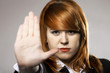 Young woman making stop gesture sign