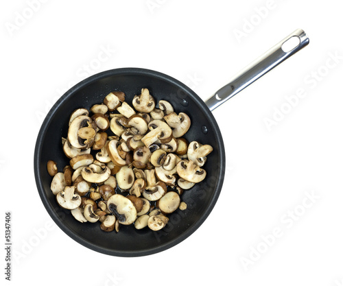 Mushrooms sauteing in skillet