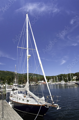 A perfect blue sky settles over pristine Camden Harbor, Maine.