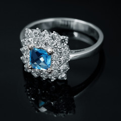 Golden jewelry ring with sapphire and brilliants