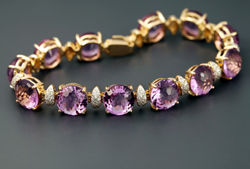 Golden jewelry  bracelet with amethysts