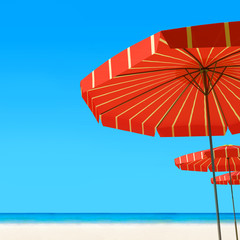 3d render of Beach umbrella on a sunny day, sea in background