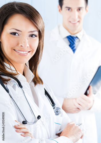 Portrait of happy smiling medical people at office