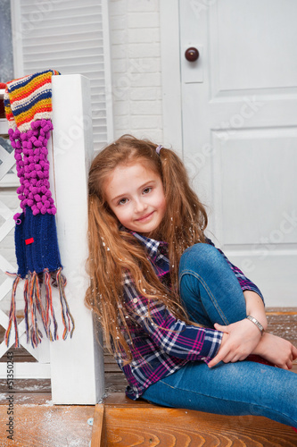 Little girl on the porch