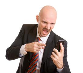 wütender Geschäftsmann schreit in das Telefon