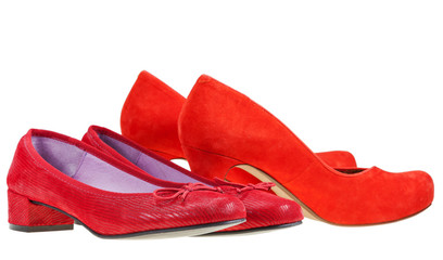 Two pairs of red woman pumps shoes