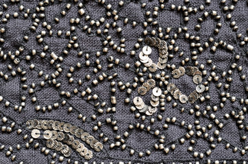 Embroidered fabric with beads