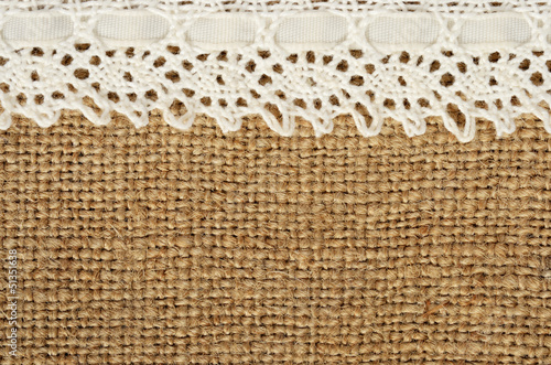 Canvas background with lace on the edge