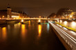 quay and pont au change in Paris at night