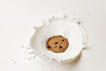 Cookie Splashing in milk.