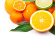 Fresh citrus fruits whole and half with green leaves, food