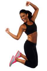 Woman in sportswear jumping with joy