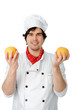 handsome cook with an orange