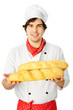 Cook holding couple breads