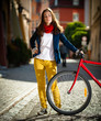 Urban biking - teenage girl and bike in city