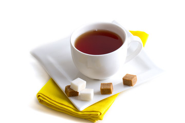 White cup of tea on a napkin