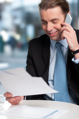 Businessman communicatng on phone