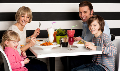 Family eating lunch together in restaurant