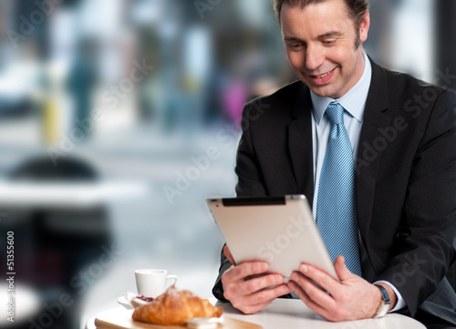 Handsome manager reviewing business updates