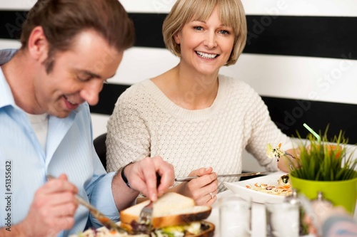 Couple enjoying breakfast in restaurant