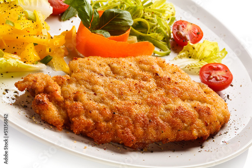 Fried pork chop and vegetable salad