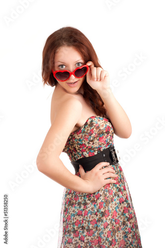 Young woman with heart shape glasses