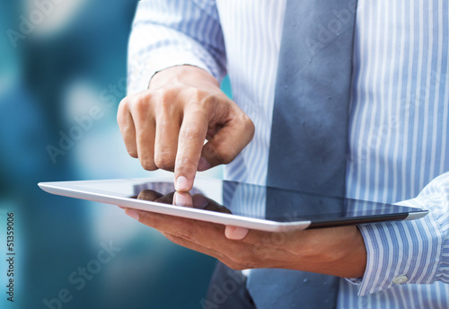 Business hand presses on screen digital tablet