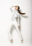 Clothing Design. Modish Woman in White Blouse and Pants. Fashion
