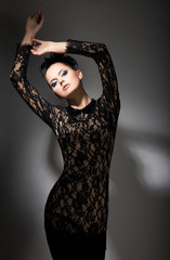 Gracefulness. Enticing Woman in Black dress in Reverie. Felicity