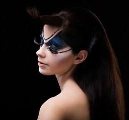 Blue Eye Shadows. Mascara. Woman with Bright Colorful Makeup