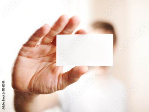 Human hand holding blank business card with copy space, small do