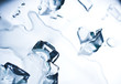 Abstract background with ice cubes over wet glass