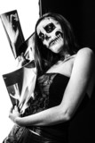 colorless picture of female zombie and x-ray images poster