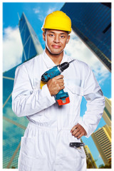 hot worker in uniform is holding a drill