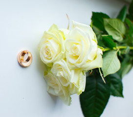 Golden rings and white roses