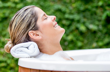 Relaxed woman in a bathtub