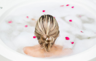 Back of woman in a foam bath