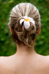 Hairstyle with a flower