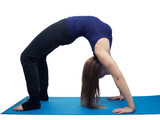 young woman yoga exercise the wheel - isolated