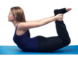 young woman yoga exercise the bow - isolated