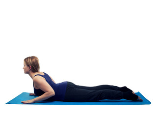 Young woman exercising yoga cobra - isolated