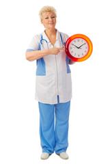 Mature nurse with clock