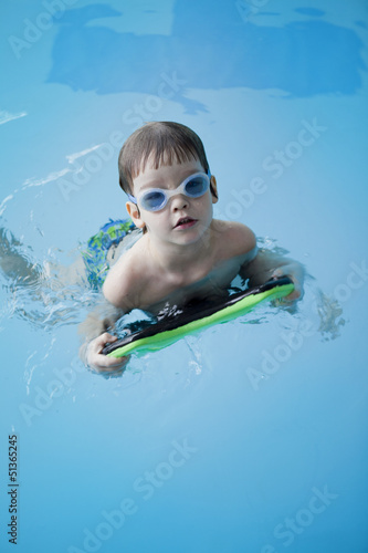 little boy have fun on swimming pool