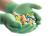 Hand with pills. Many colorful pills on two hands
