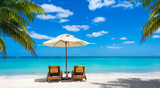 two deckchairs on the idyllic white beach turquoise sea