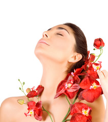 Beautiful woman with red orchid flowers