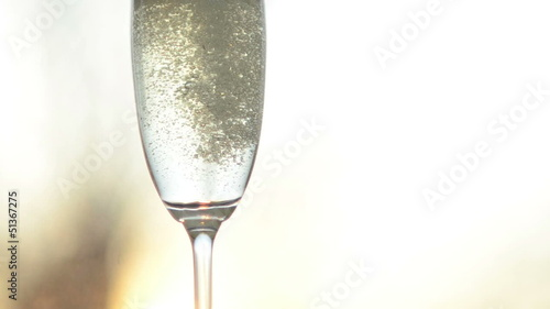 A glass filled with champagne