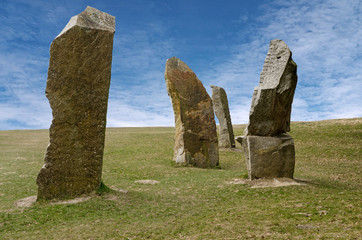 Standing stones against blue sky