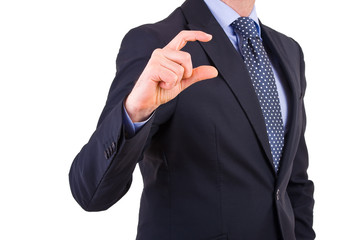 Businessman gesturing small size with fingers.