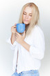 Blond female with cup of tea